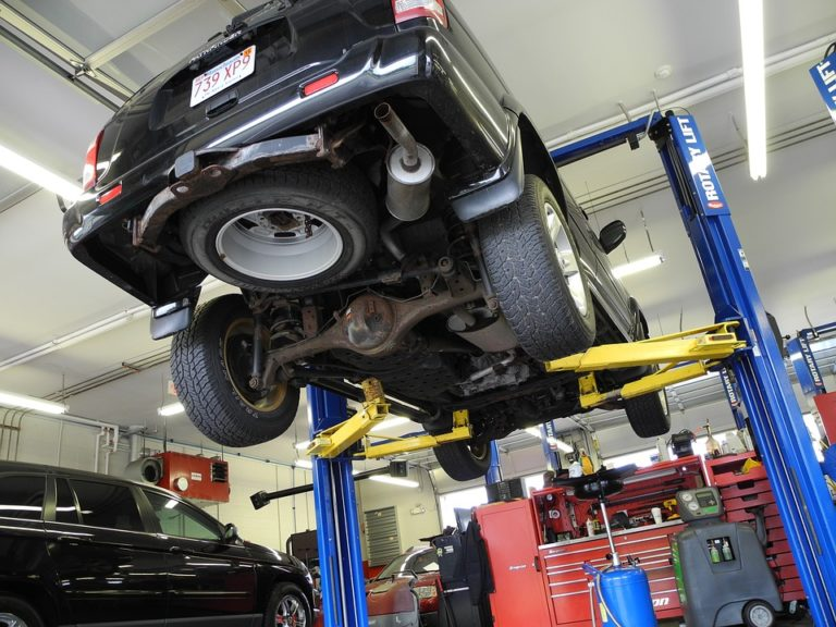 car-on-lift-at-auto-body-shop